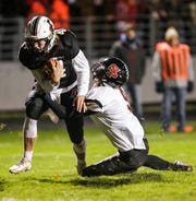 Fond du Lac's Carson Raddatz tries to break a tackle from Stevens Point's Luke Bembenek during their game Oct. 12 at Fruth Field. Raddatz ended the regular season with a 119.3 passer rating.