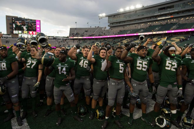 Colorado State University's football team stands in front of the marching band and sings the school fight song following an Oct. 13, 2018, homecoming win over New Mexico at Canvas Stadium. CSU has completed its football schedules through 2022 by adding a home game that year against Sacramento State.