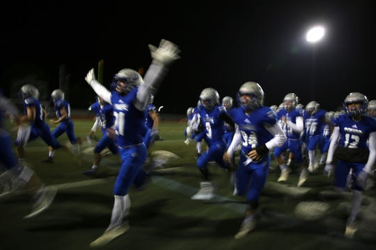 Poudre High School players rush toward the stands following their win over Horizon on Oct. 12, 2018. Poudre beat the visiting Horizon Hawks by a score of 26-21.