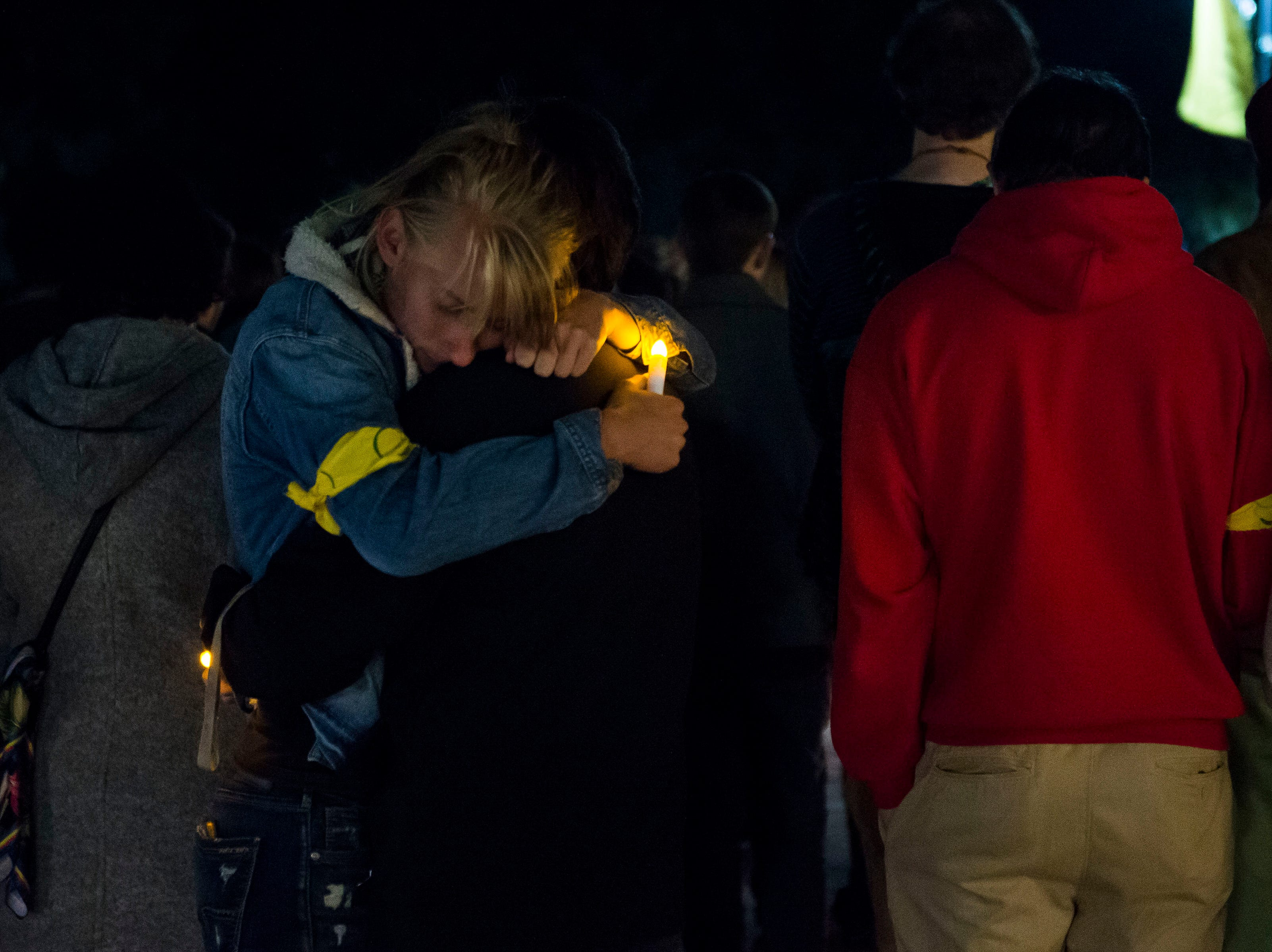 Vigil participants embrace during a candlelight vigil on the 20th anniversary of Matthew Shepard's death on Friday, Oct. 12, 2018, at Prexy's Pasture on the University of Wyoming campus in Laramie, Wyo.