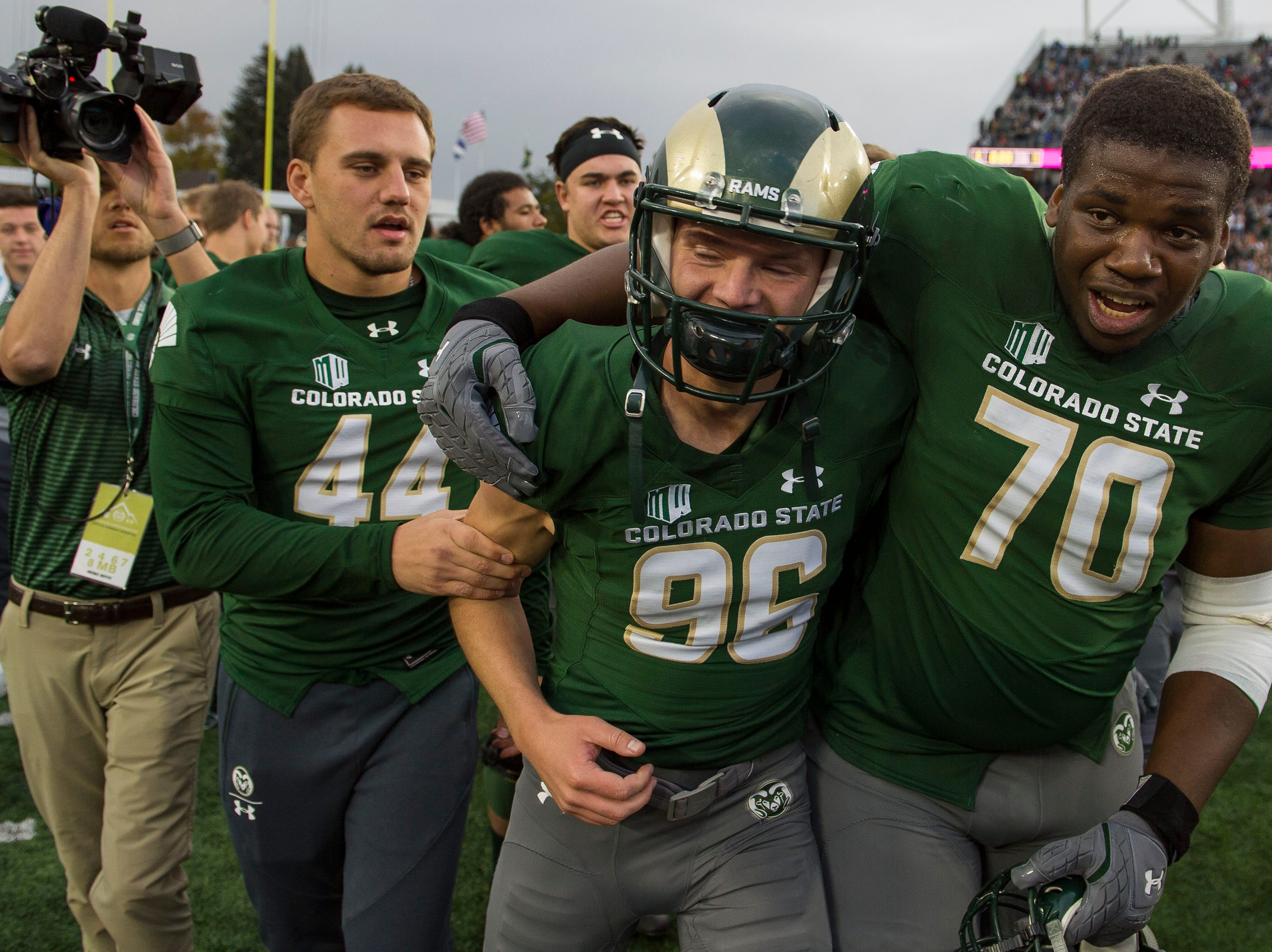 Colorado State University senior kicker Wyatt Bryan (96) is greeted by teammates Joctavis Phillips (70) and Max McDonald (44) after hitting a game-winning field goal against New Mexico on Saturday, Oct. 13, 2018, at Canvas Stadium in Fort Collins, Colo.