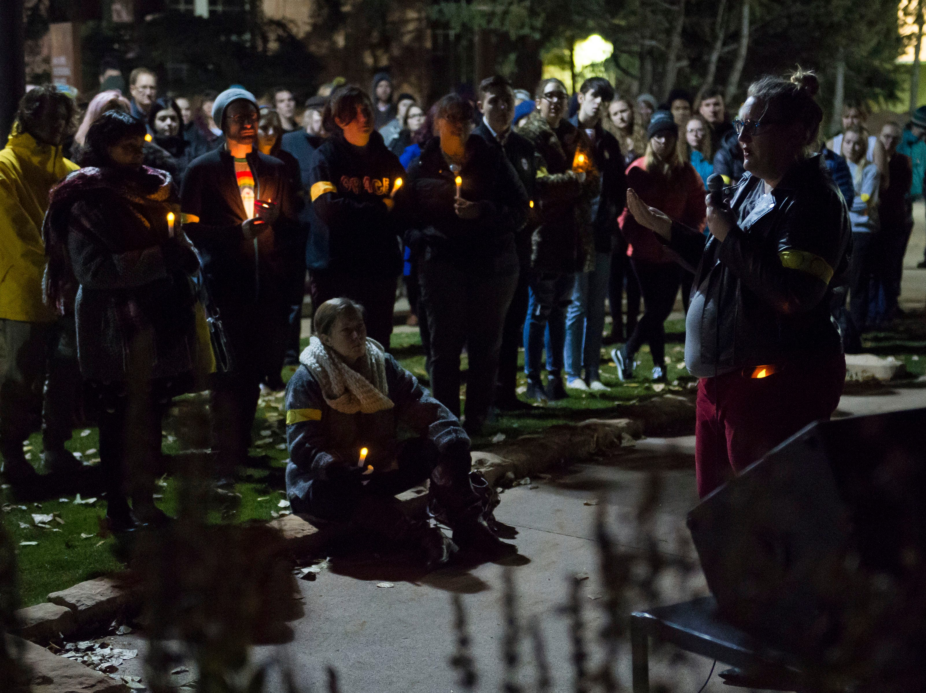 Executive director of Wyoming Equality Sara Burlingame speaks during a candlelight vigil on the 20th anniversary of Matthew Shepard's death on Friday, Oct. 12, 2018, at Prexy's Pasture on the University of Wyoming campus in Laramie, Wyo.