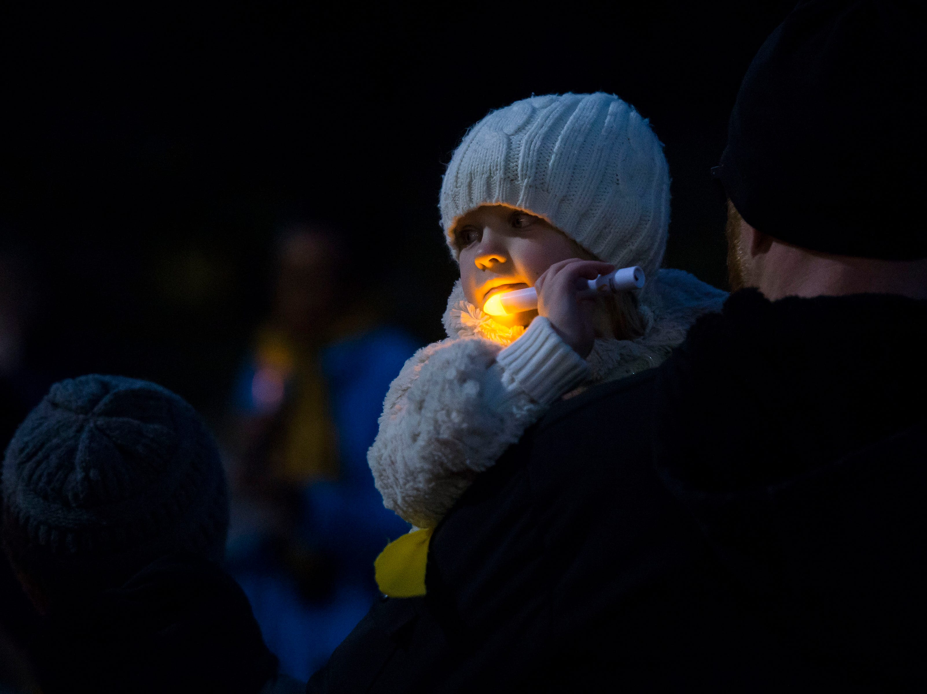 Greta LeFevre, 5, is held by her father Bob during a candlelight vigil on the 20th anniversary of Matthew Shepard's death on Friday, Oct. 12, 2018, at Prexy's Pasture on the University of Wyoming campus in Laramie, Wyo.