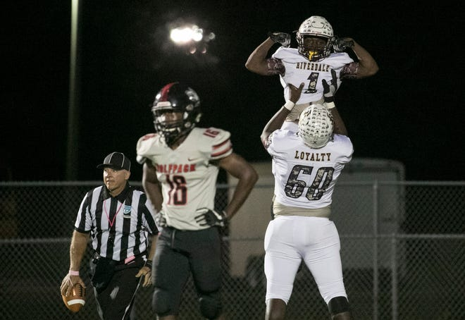 Quantavious Brown of Riverdale celebrates with Trevon Dickerson after scoring a touchdown against South Fort Myers on Friday, October 12, 2018, at South Fort Myers High School.