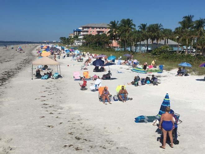 Hundreds of beach-goers lined Fort Myers Beach Saturday. The main issue seemed to be seaweed that washed ashore.