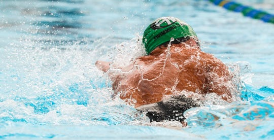 Cameron Dolly, Fort Myers, won the Boys 50 Free with a time of 22.58. Kirk Klemm came in second with a time of 22.71.  They shook hands after the race. LCAC Swimming championships held at FGCU, October 13, 2018.