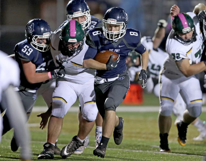 Bay Port's Carter Zawlocki scampers toward the end zone against Green Bay Preble on Friday night in Suamico.
