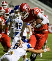 Greenville quarterback Davis Beville (11) is taken down by Travelers Rest's Brooks Russ-Martin (8) at Sirrine Stadium on Friday, Oct. 12, 2018.