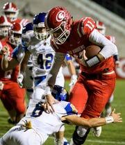 Greenville quarterback Davis Beville (11) is taken down by Travelers Rest's Brooks Russ-Martin (8) at Sirrine Stadium on Friday, Oct. 12, 2018.