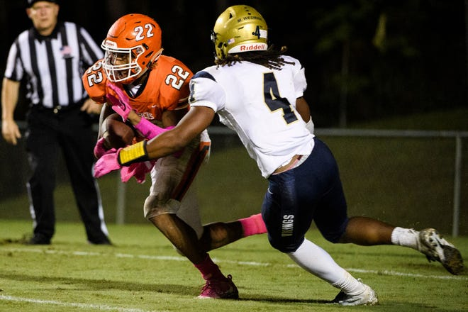 Mauldin's Devon Scott (22) tries to get past Spartanburg's Moe Wedman (4) during the Mavericks' 13-7 win Friday night at Freeman Field. Scott scored the decisive touchdown in overtime.