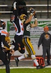 CMR's Keegan Barnes makes a catch in front of Flathead's Seth Moon during Friday night's football game at Memorial Stadium.