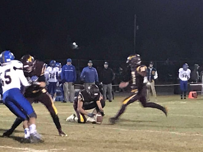 Shelby kicker Wyatt Brusven puts his foot into a field goal try in the first half of the Coyotes' 34-0 win over Great Falls Central Friday night in Shelby. The kick was blocked.
