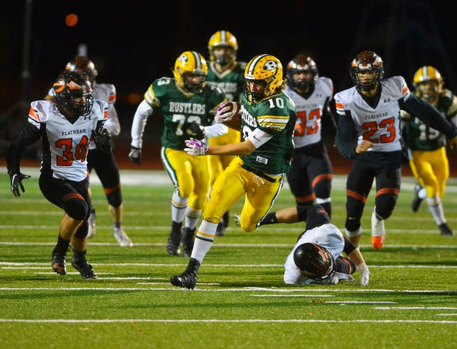 CMR's Tucker Greenwell returns a kick during Friday night's football game against Flathead High at Memorial Stadium.