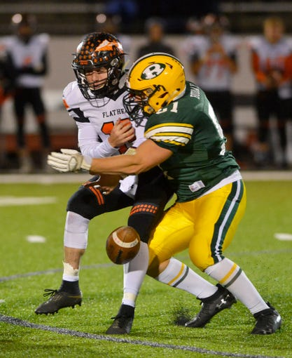 CMR's Chance Buday strips and sacks Flathead High quarterback Jaden Macneil during Friday night's football game at Memorial Stadium.
