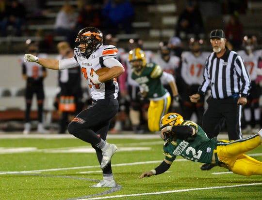 Flathead High running back Blake Counts carries the ball in Friday night's football game against CMR at Memorial Stadium.