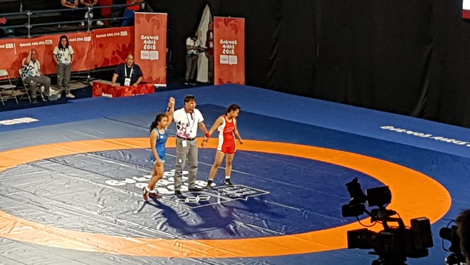 Paulina Duenas is victorious in her women's freestyle wrestling match against Cambodia's Sopealai Sim at the Buenos Aires Youth Olympic Games on Oct. 13, 2018.