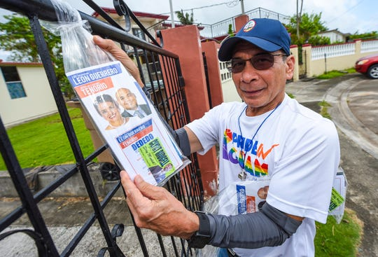 Danny Leon Guerrero, 64, leaves a packet of campaign brochures as he and other supporters of the Democratic gubernatorial team of Lou Leon Guerrero and Josh Tenorio canvass a residential neighborhood of Liguan Terrace, Dededo on Saturday, Oct. 13, 2018.