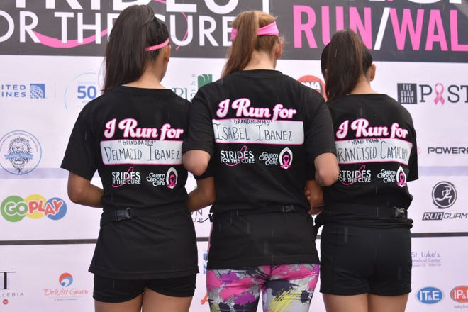 Participants in the 17th annual Strides for the Cure 2K/5K event held Oct. 6 show their reason for participating.