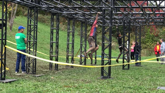 Michael Quitugua, swings his way through the Trench Challenge course. Quitugua represented Guam at OCR World Championships in Canada in 2017.