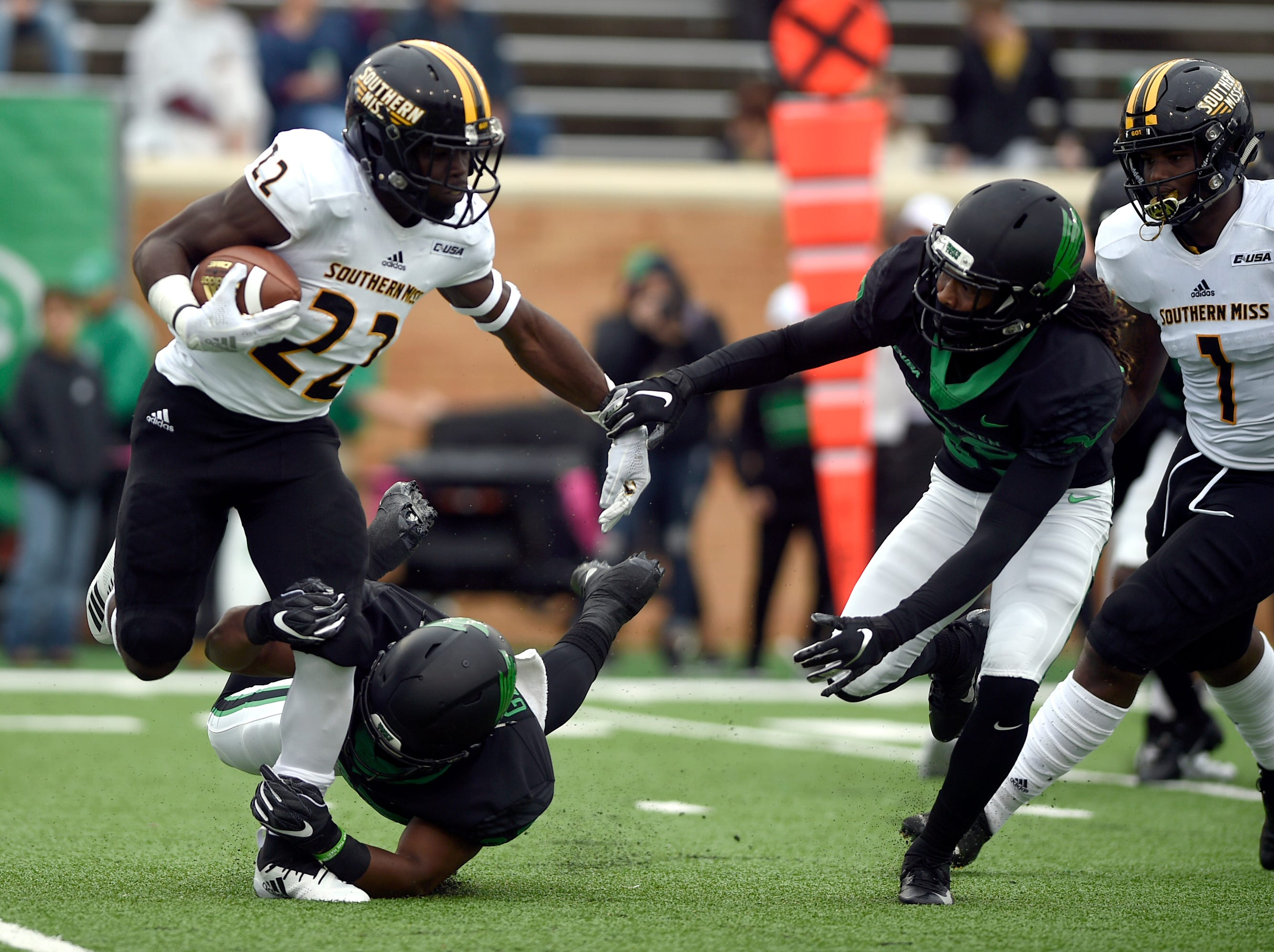 North Texas defensive back Jameel Moore (39) dives in to tackle Southern Miss running back Trivensky Mosely (22) during an NCAA college football game at Apogee Stadium in Denton, Texas on Saturday, Oct. 13, 2018.