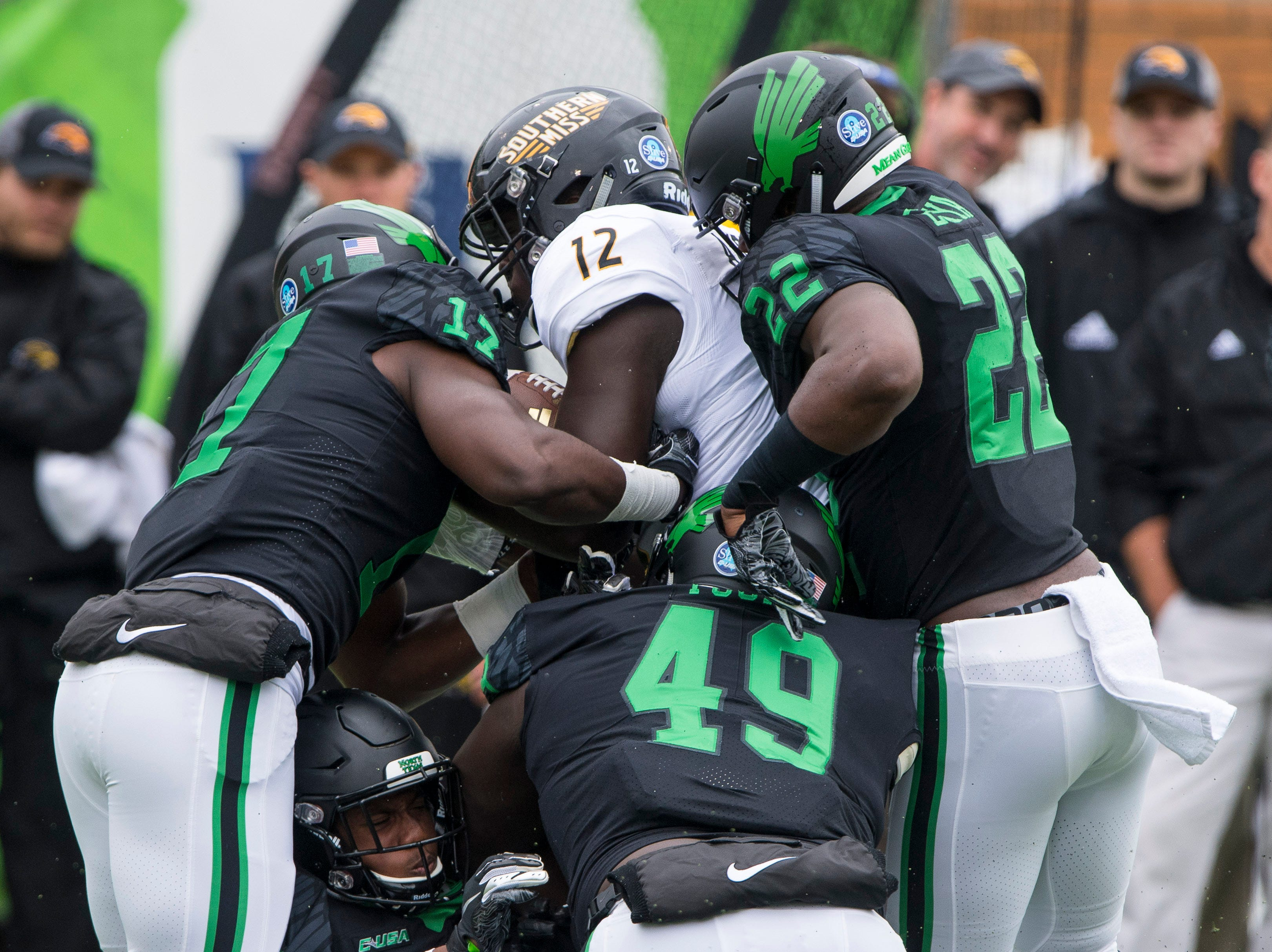 Oct 13, 2018; Denton, TX, USA; Southern Miss Golden Eagles running back Steven Anderson (12) is gang tackled by the North Texas Mean Green defense during the first half at Apogee Stadium.