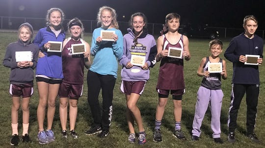 Middle School Boys and Girls All County Cross-Country Team recipients were, from left, Allina Decker, Sara Krampe, Addison Grossman, Hadley Wolfe, Alyssa Shelton, Rex Blue, Creek Tompkins, Nathan Baird. Not pictured are Aiden Miller and Davion Neighbors.