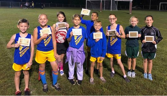 Elementary Boys and Girls All County Cross-Country First Team recipients were, from left,  Jordan Haynes, Sonny Shelton, Cadyn Conrad, Lilyann Chaney, Lincoln Black, Jackson Monroe, Brian Pardue, Madi Latta, and Allie Green. Not pictured is Paislee Toombs.