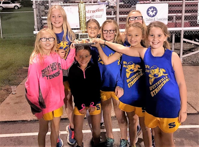 The Spottsville Elementary girls team took first place in the district cross country championships