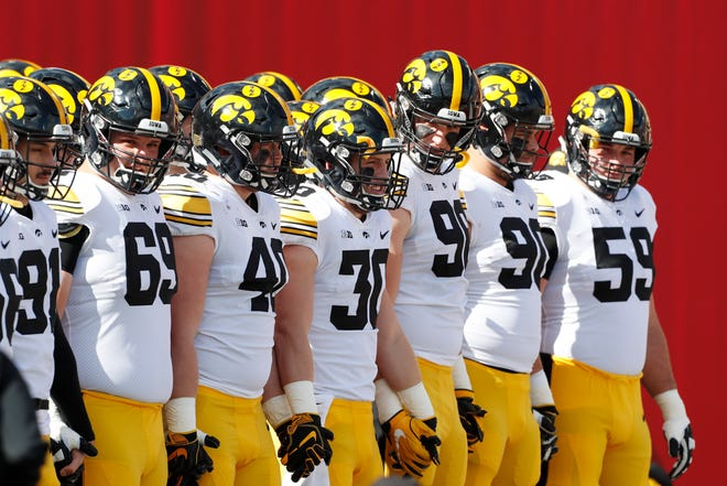 Iowa Hawkeyes wait for player introductions before the game against the Indiana Hoosiers at Memorial Stadium.