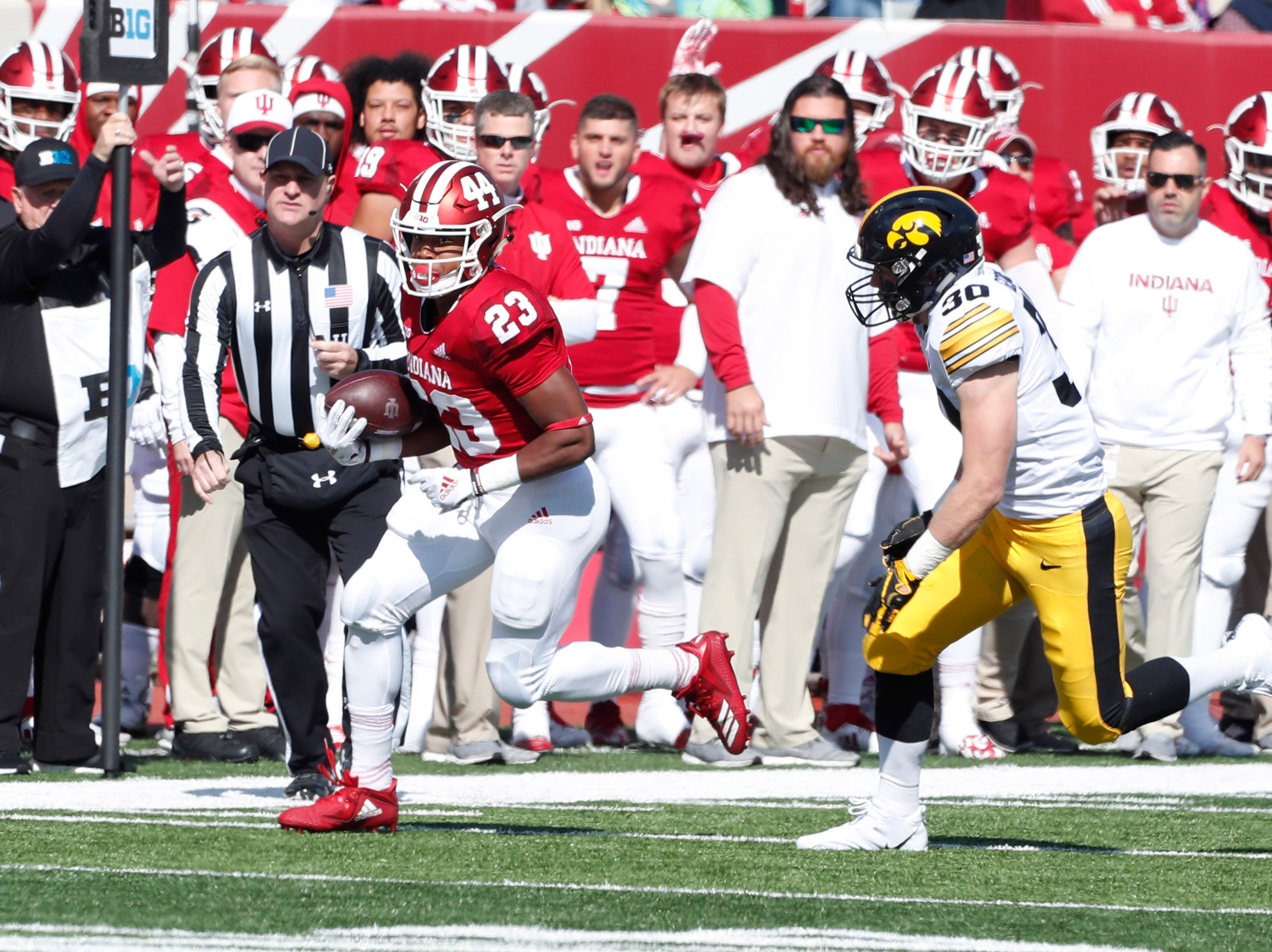 Indiana Hoosiers running back Ronnie Walker Jr. (23) runs with the ball against  Iowa Hawkeyes defensive back Jake Gervase (30) during the first quarter at Memorial Stadium.