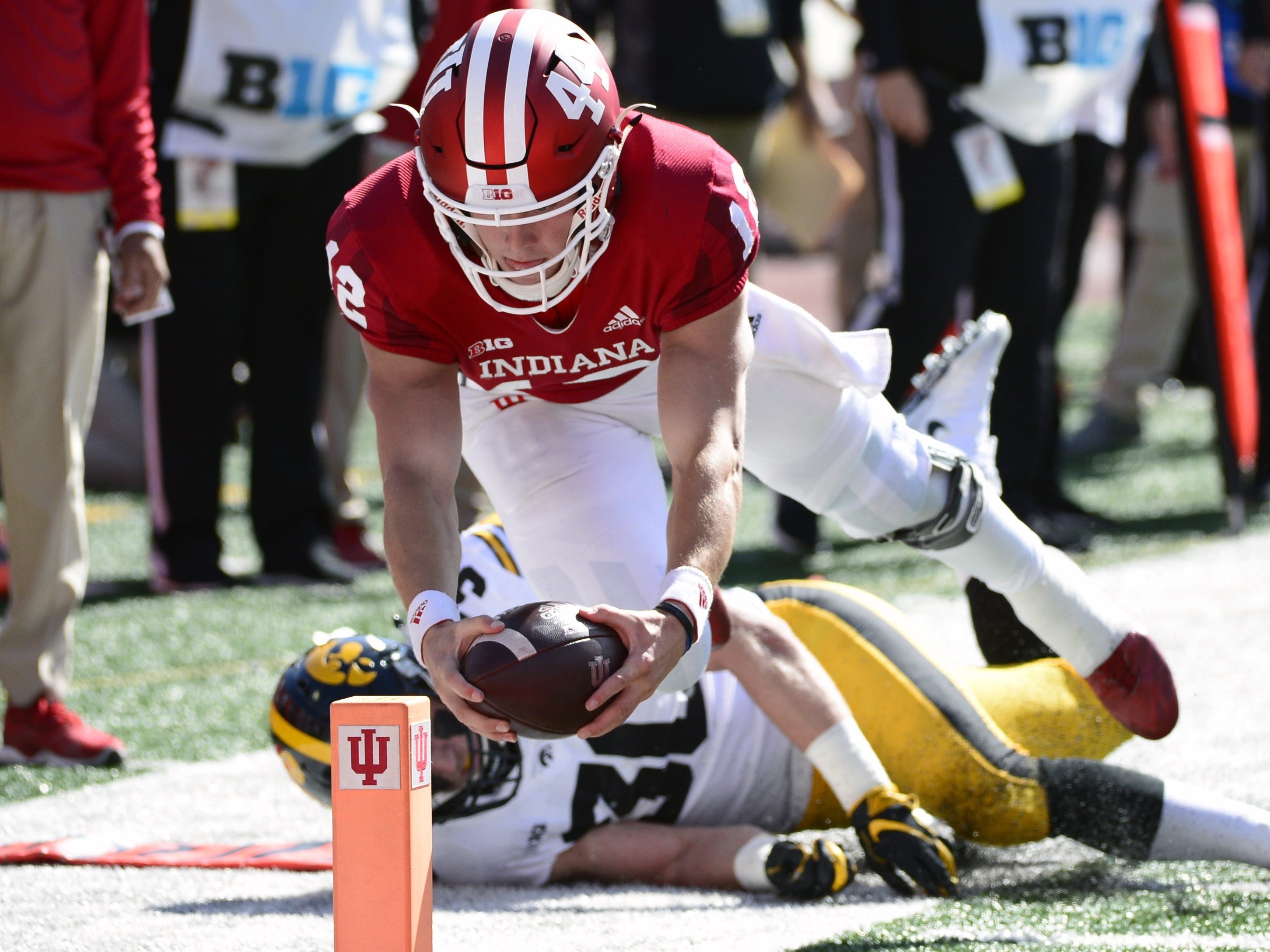 Indiana Hoosiers quarterback Peyton Ramsey (12) dives for the endzone against Iowa at Memorial Stadium in Bloomington, Ind., on Saturday, Oct. 13, 2018.