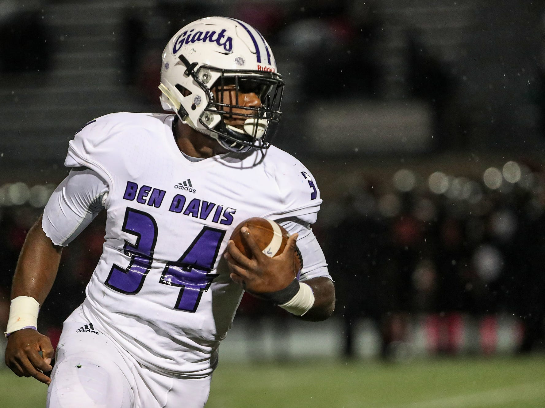 Ben Davis Giants running back Delbert Mimms (34) carries the ball in the first half of the game at North Central High School in Indianapolis, Oct. 12, 2018.