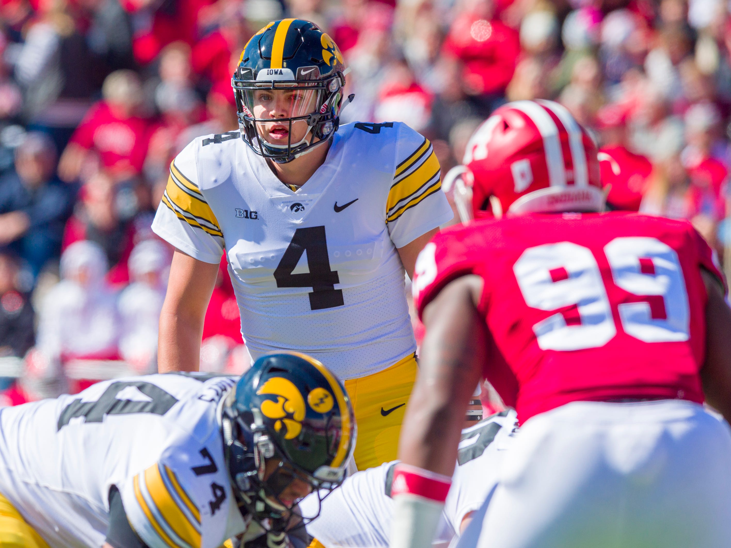 Iowa quarterback Nate Stanley (4) calls a play out to the offense during the first half of an NCAA college football game against Indiana, Saturday, Oct. 13 2018, in Bloomington, Ind. (AP Photo/Doug McSchooler)
