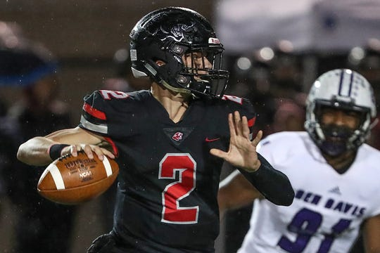 North Central Panthers Liam Thompson (2) looks for an open receiver in the first half of the game at North Central High School in Indianapolis, Oct. 12, 2018.