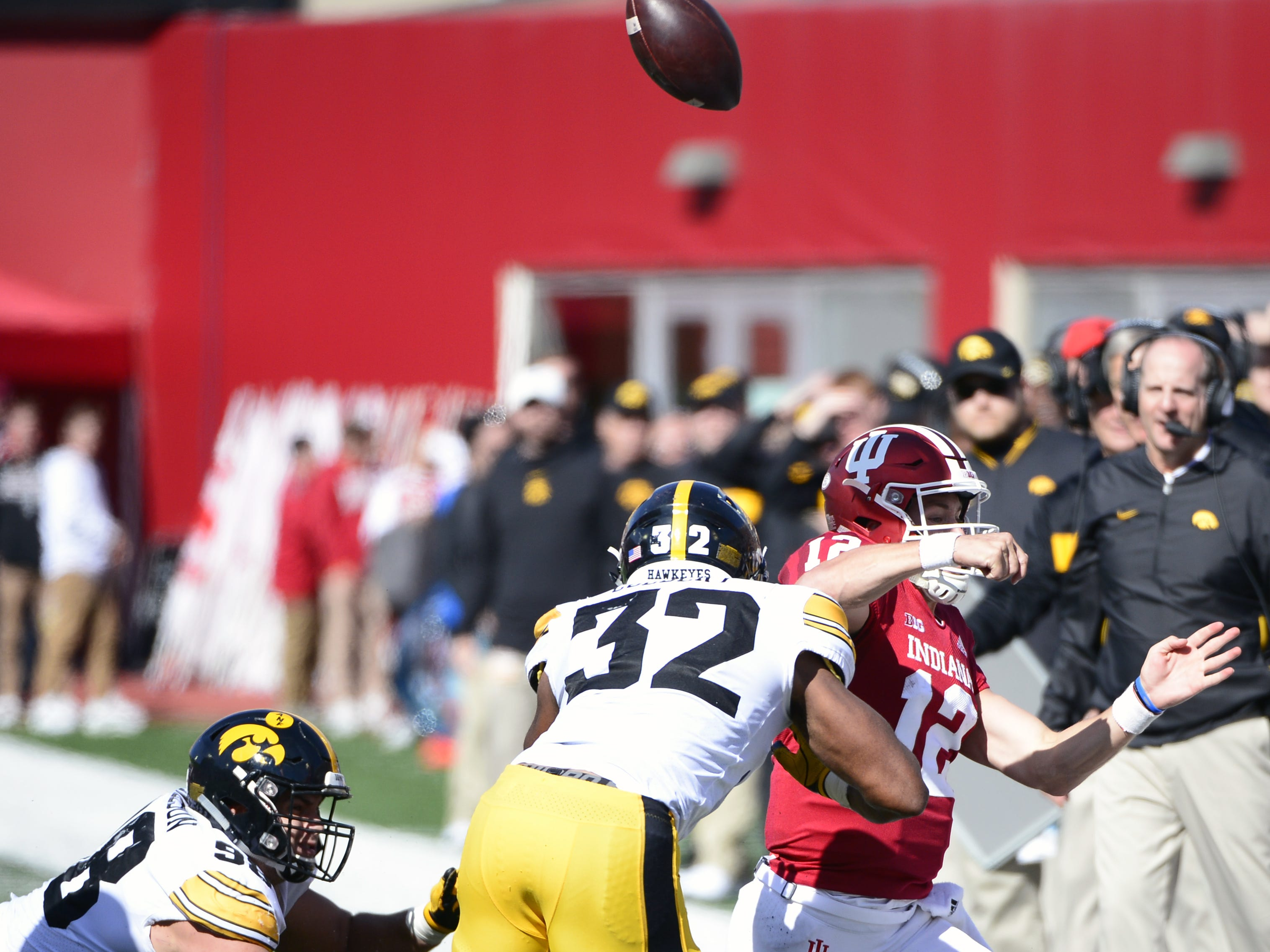 Indiana Hoosiers quarterback Peyton Ramsey (12) gets rid of the ball as he is tackled during the game against Iowa at Memorial Stadium in Bloomington, Ind., on Saturday, Oct. 13, 2018.