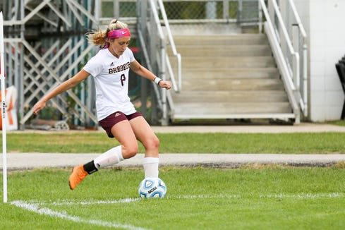 Brebeuf's Sophie Weeter (8) makes a corner kick during the first half of Brebeuf vs. Park Tudor Marion County Girls Soccer Championship held at North Central High School, September 29, 2018.