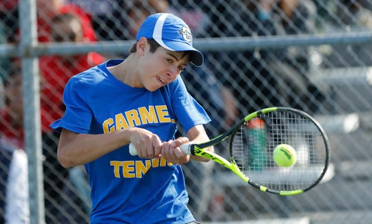Carmel High School's Broc Fletcher takes on North Central High School's Ajay Mahenthiran during the 52nd Annual IHSAA Boys Team Tennis State Finals, held at North Central High School in Indianapolis on Saturday, October 13, 2018.