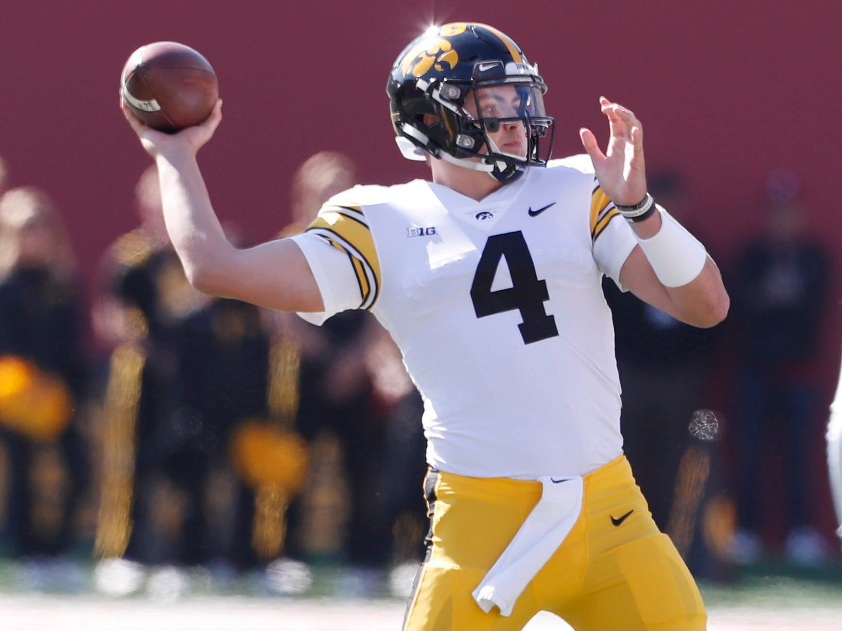 Iowa Hawkeyes quarterback Nate Stanley (4) throws a pass against the Indiana Hoosiers during the first quarter at Memorial Stadium .