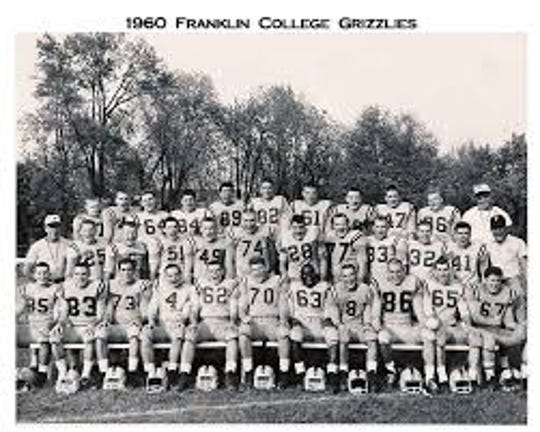 "Coach ""Red"" Faught with his 1960 Franklin College football team."