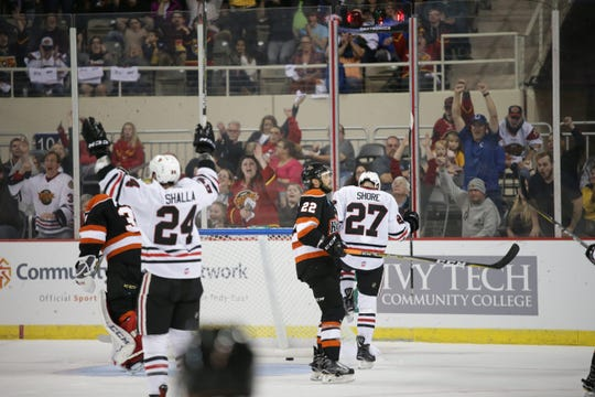 Josh Shalla celebrates Quentin Shore's goal in the Fuel's 3-1 loss to Fort Wayne in Saturday's season opener.