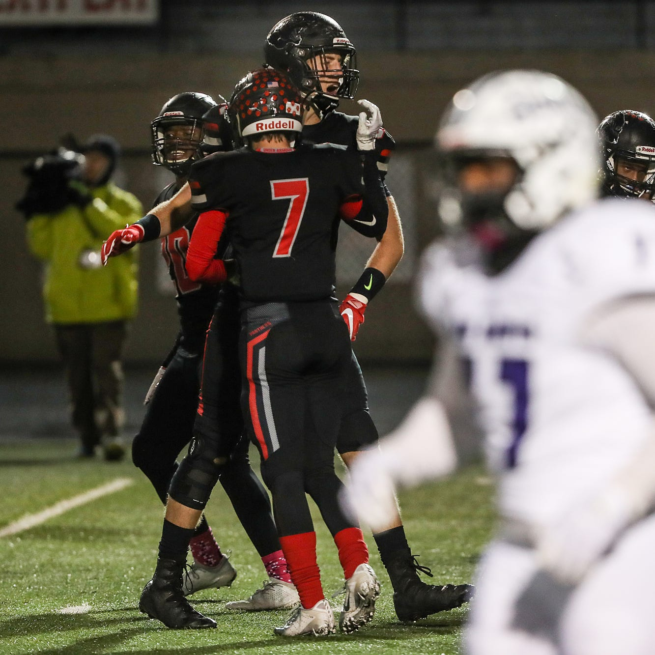 The North Central Panthers celebrate after recovering a fumble on a Giants first and goal play in the second half of the game at North Central High School in Indianapolis, Oct. 12, 2018. North Central won, 38-23.
