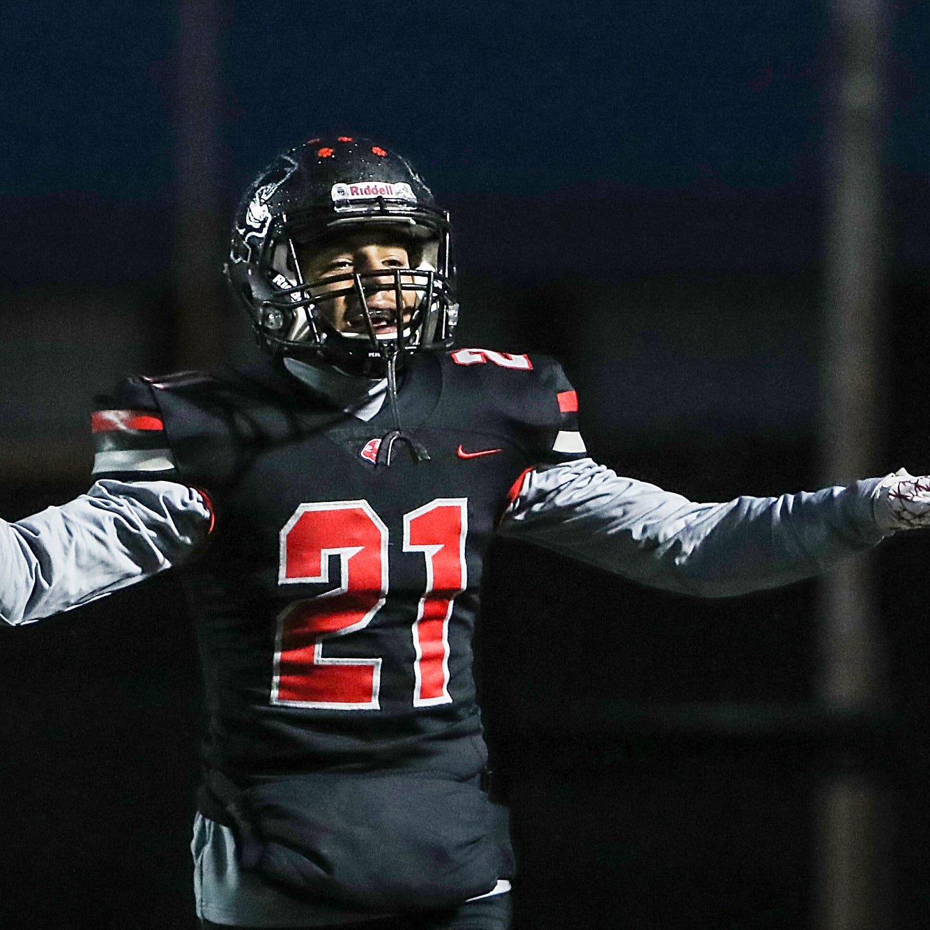 North Central Panthers cornerback Theran Johnson (21) celebrates after he intercepted a pass intended for Ben Davis Giants wide receiver Dominic Day (8) in the first half of the game at North Central High School in Indianapolis, Oct. 12, 2018.