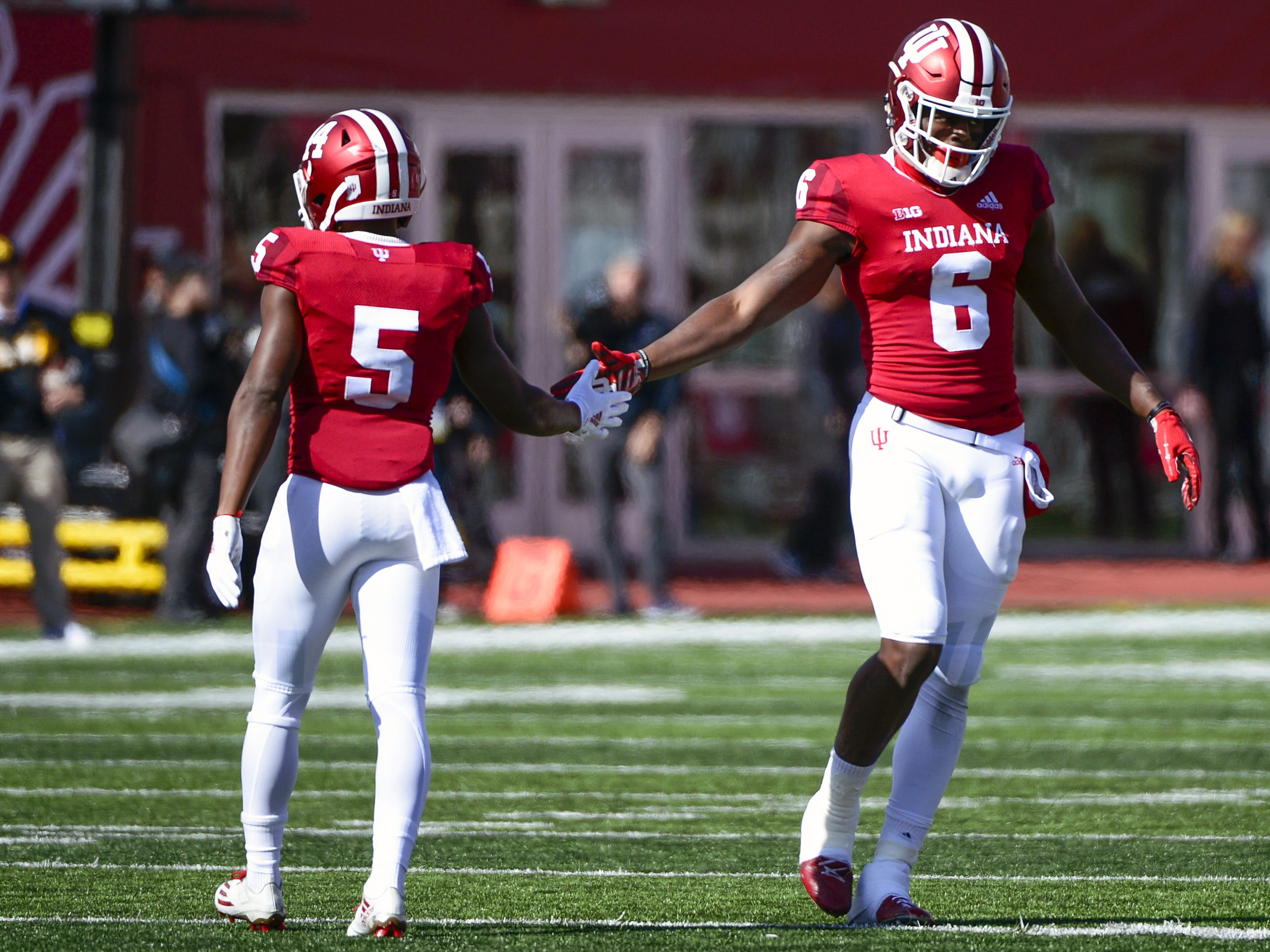 Indiana Hoosiers wide receivers J-Shun Harris II (5) and Donovan Hale (6) high five during the game against Iowa at Memorial Stadium in Bloomington, Ind., on Saturday, Oct. 13, 2018.