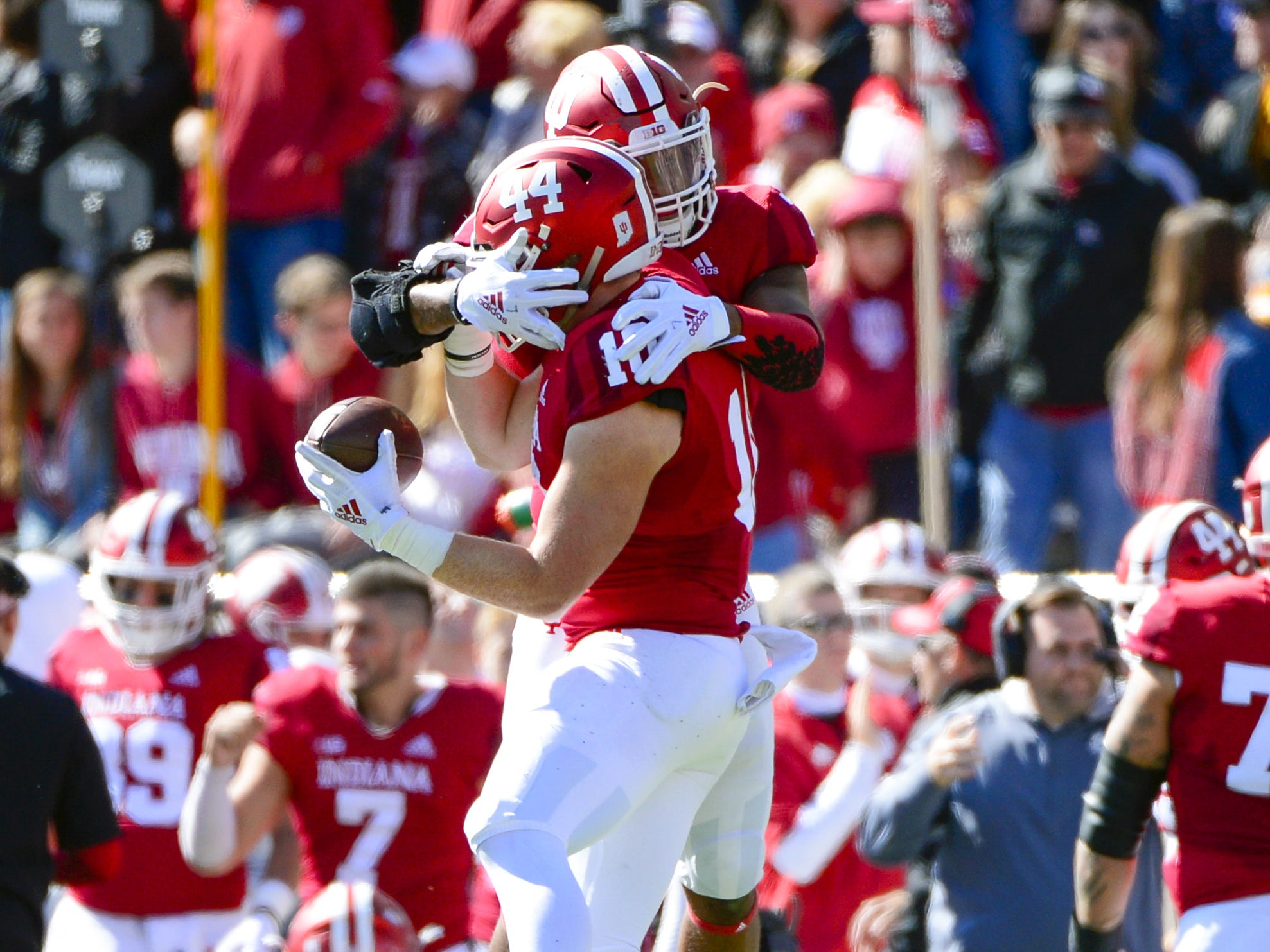 Indiana Hoosiers linebacker Thomas Allen (10) celebrates with a teammate after an interception against Iowa at Memorial Stadium in Bloomington, Ind., on Saturday, Oct. 13, 2018.