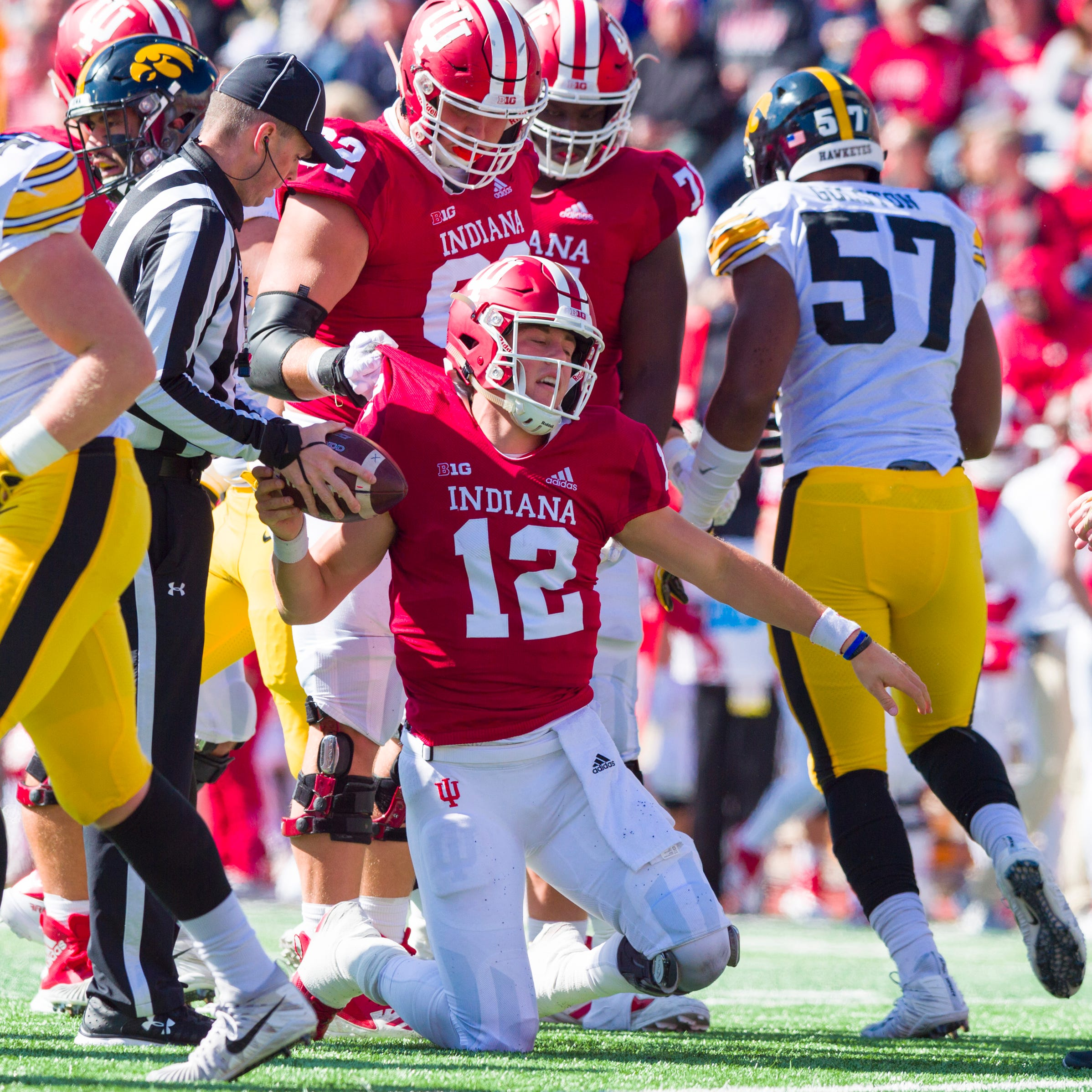 Indiana quarterback Peyton Ramsey (12) is helped...
