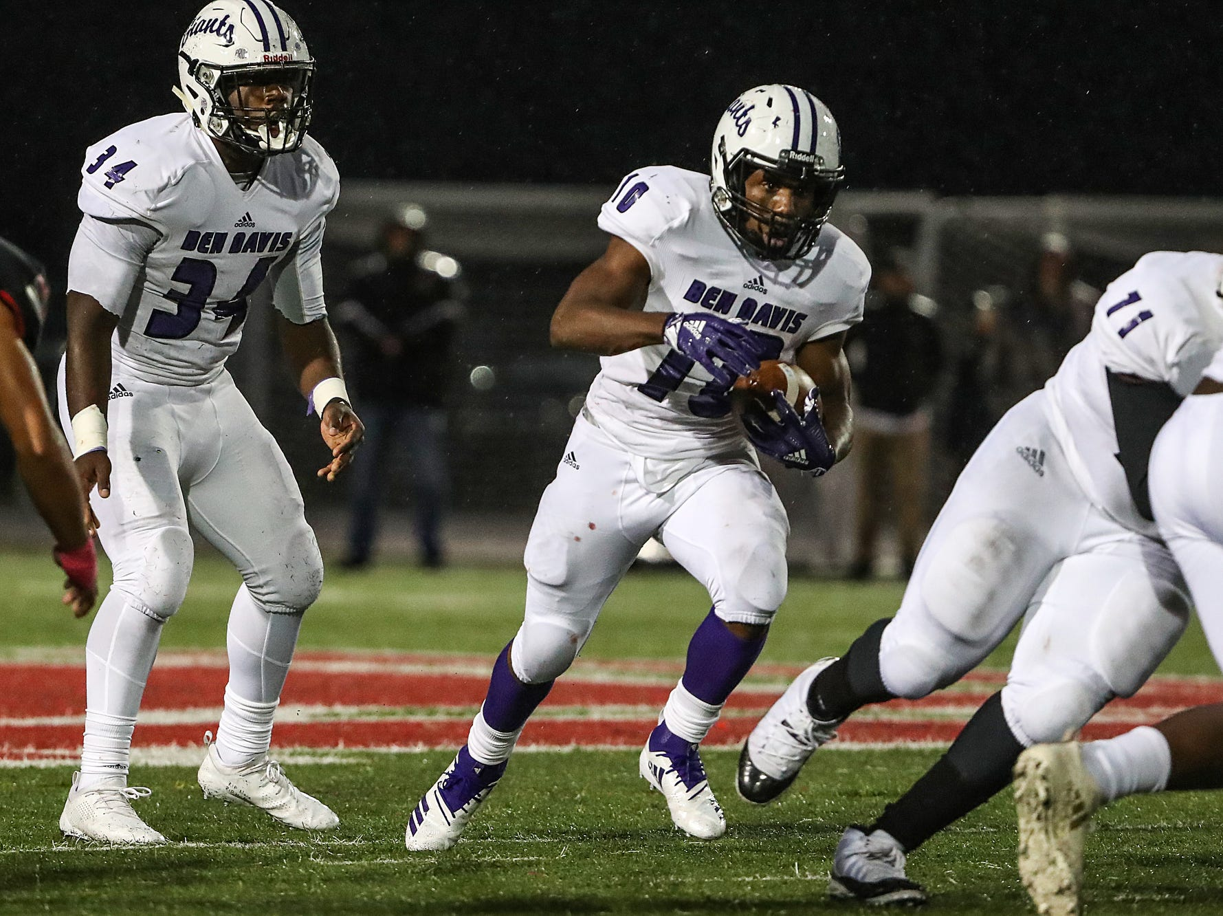 Ben Davis Giants running back Alijawon Hassel (10) takes a hand off from Delbert Mimms (34) in the first half of the game at North Central High School in Indianapolis, Oct. 12, 2018.