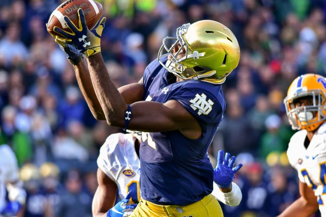 Notre Dame Fighting Irish wide receiver Miles Boykin (81) catches the game winning catch for a touchdown in the fourth quarter against the Pittsburgh Panthers at Notre Dame Stadium.