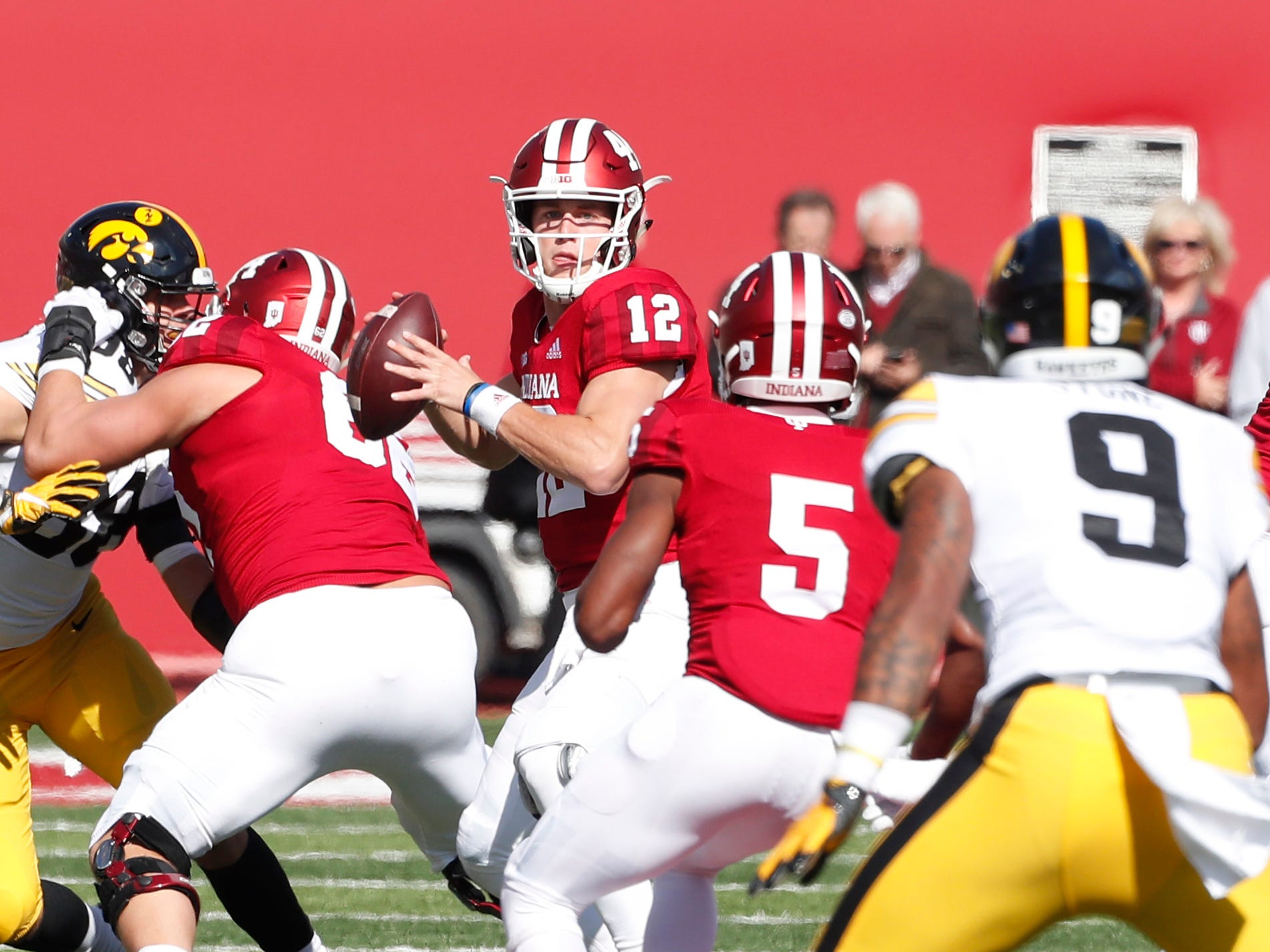 Indiana Hoosiers quarterback Peyton Ramsey (12) throws a pass against the Iowa Hawkeyes during the first quarter at Memorial Stadium .