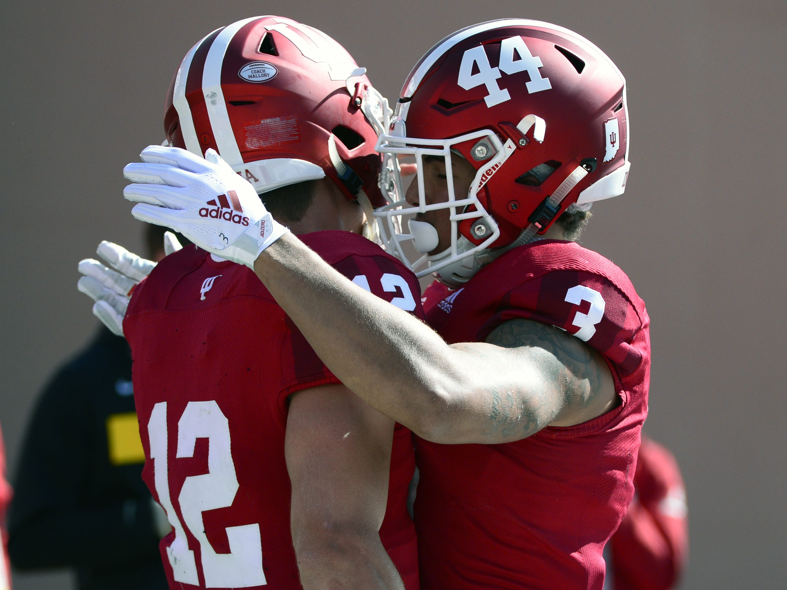 Indiana Hoosiers quarterback Peyton Ramsey (12) celebrates with wide receiver Ty Fryfogle (3) after scoring a touchdown against Iowa at Memorial Stadium in Bloomington, Ind., on Saturday, Oct. 13, 2018.