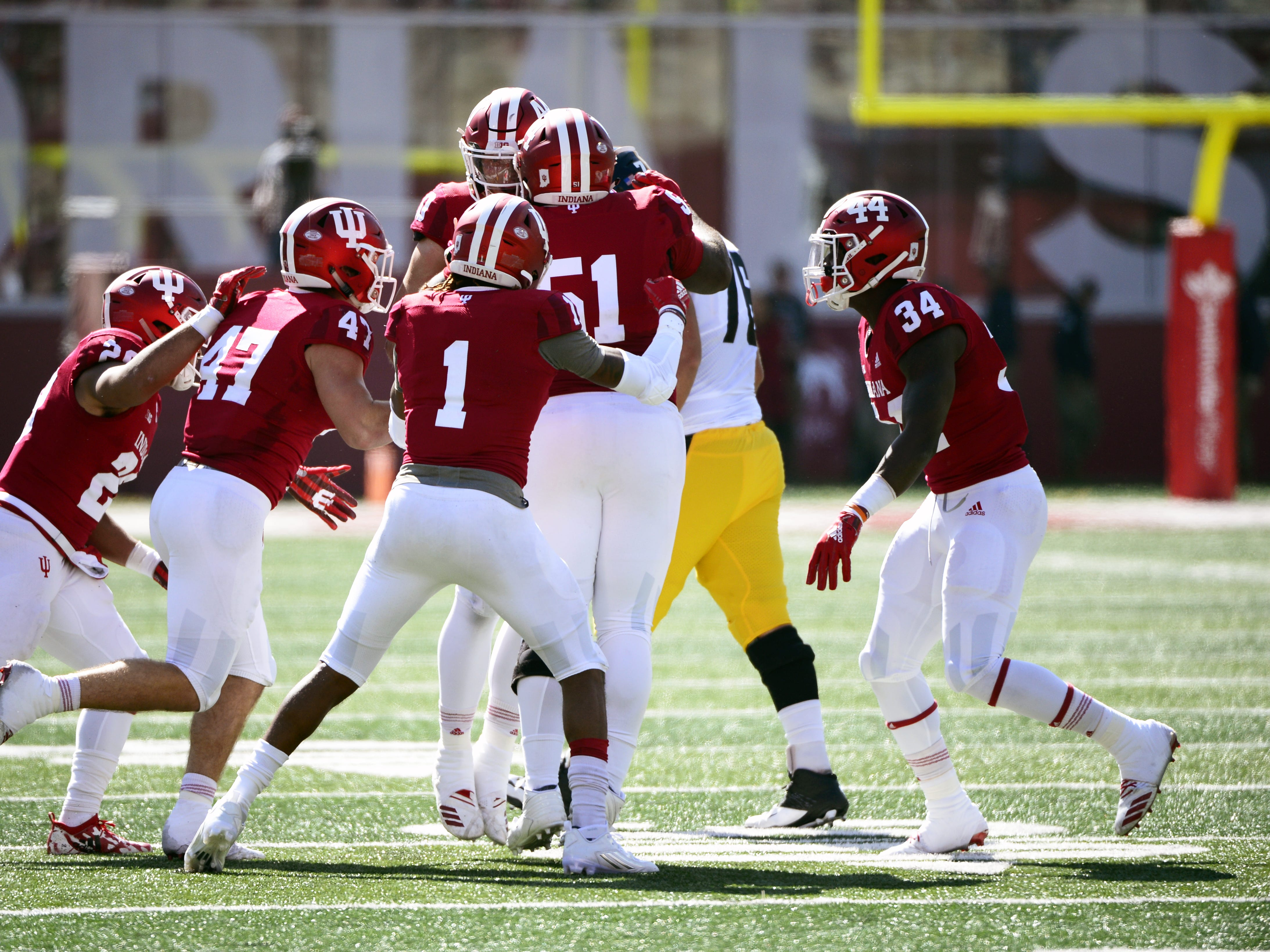 The Indiana Hoosiers celebrate after an interception by linebacker Thomas Allen (10) against Iowa at Memorial Stadium in Bloomington, Ind., on Saturday, Oct. 13, 2018.